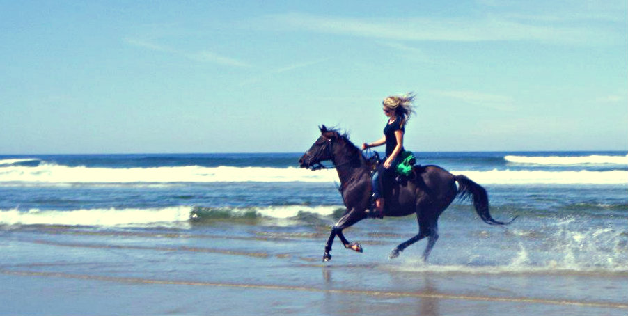 riding horses on the beach in Oregon